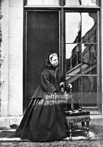 Queen Victoria of Great Britain with her pet dog 'Sharp' at Balmoral Castle near Ballater in the Scottish Highlands Victoria's late husband Prince...