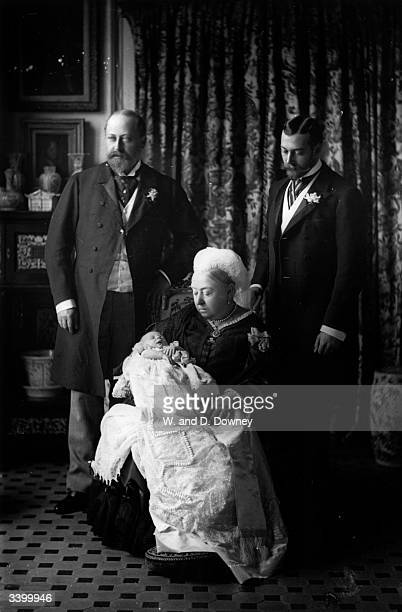 Queen Victoria of Great Britain with her son Edward later King Edward VII her grandson George later King George V and her greatgrandson Edward later...