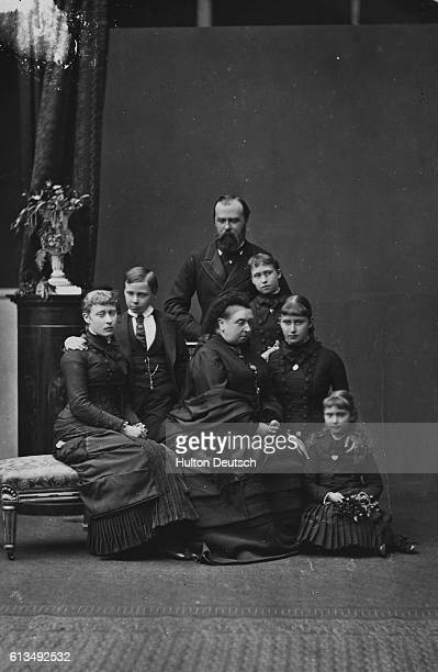 Queen Victoria two months after the death of her daughter Princess Alice. Also shown are Princess Alice's husband and children.