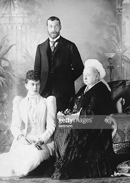 Queen Victoria with her grandson Prince George and his wife Princess Mary.