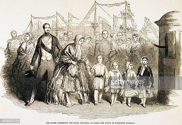 Queen Victoria with Prince Albert in 1849. They are depicted presenting their royal children to the crowds in Ireland's Kingstown harbour whilst on a...