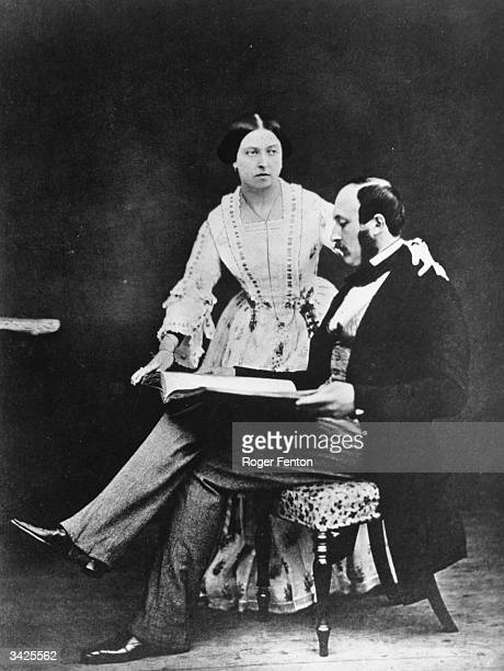 Queen Victoria with Prince Albert shortly before he went to the Crimea 1854 Prince Albert is reading while Victoria stands beside him with a hand on...