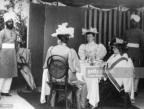 Queen Victoria with Princess Victoria of Schleswig Holstein Princess Beatrice Princess Henry of Battenberg Sheikh Ghulan Mustaha and Sheikh Chidda...