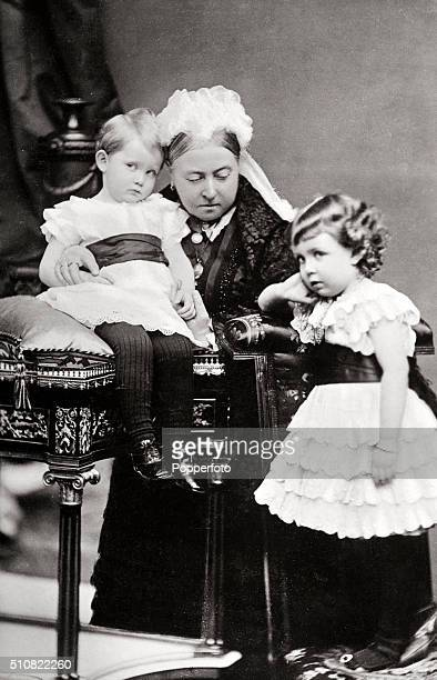 Queen Victoria with two of her grandchildren Prince George later King George V and Prince Albert Victor circa 1868