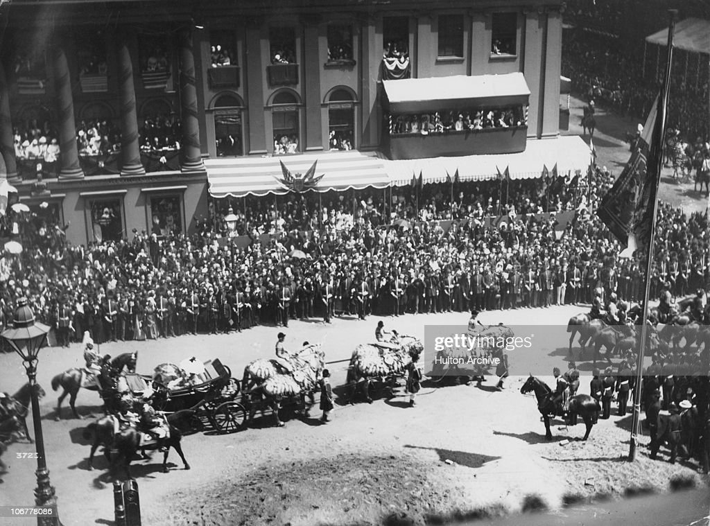 Queen Victoria's carriage passing through a London street during her Golden Jubilee procession, 22nd June 1887.