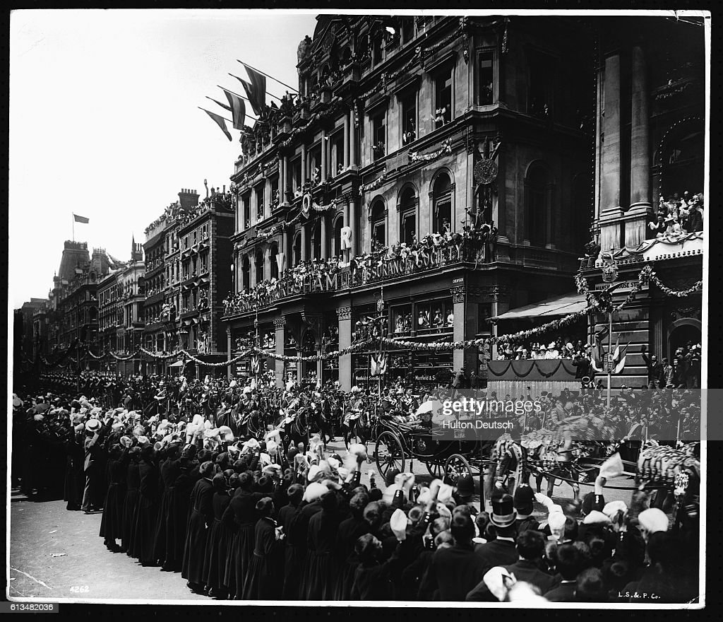 Crowds in London watching Queen Victoria passing in her
