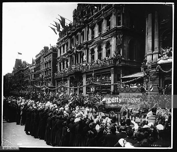 Queen Victoria's Diamond Jubilee Procession through London passes down Mansion House Street watched by waving crowds