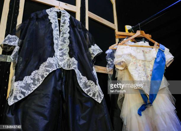 Queen Victoria's dresses hang in the quick change area back stage before the World Premier of Northern Ballet's performance of 'Victoria' at Leeds...