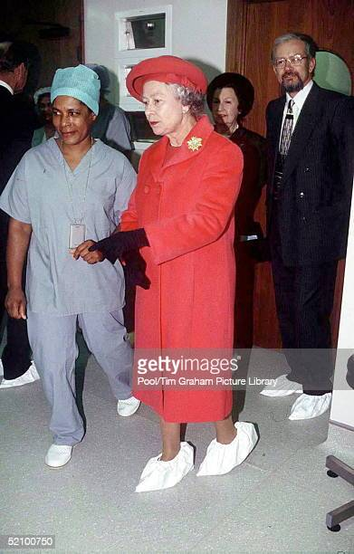 Queen Visiting St Luke's Hospital For The Clergy In London. Wearing Covers Over Her Shoes As A Hygiene Precaution.