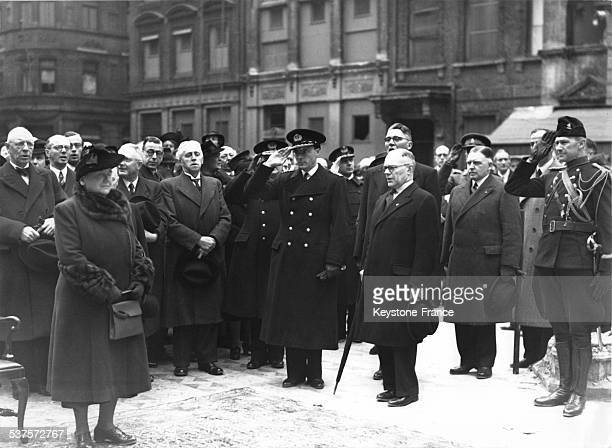 Queen Wilhelmina and Prince Bernhard are surrounded by officials during a ceremony in May 1941 in London United Kingdom