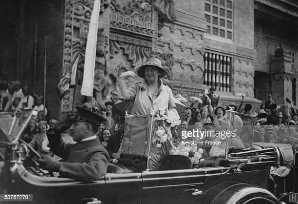 Queen Wilhelmina and Princess Juliana are welcomed the cheering crowd at the exit of Netherlands pavilion during the inauguration of the Colonial...