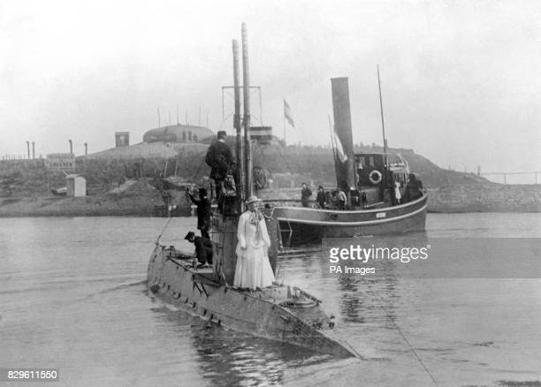 Queen Wilhelmina of Holland atop a submarine which had occasion to dive twice while she was on board