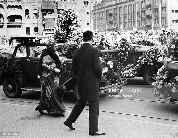 Queen Wilhelmina of the Netherlands reviews the flowering cars at the flower festival in Amsterdam in the Netherlands on September 9 1933