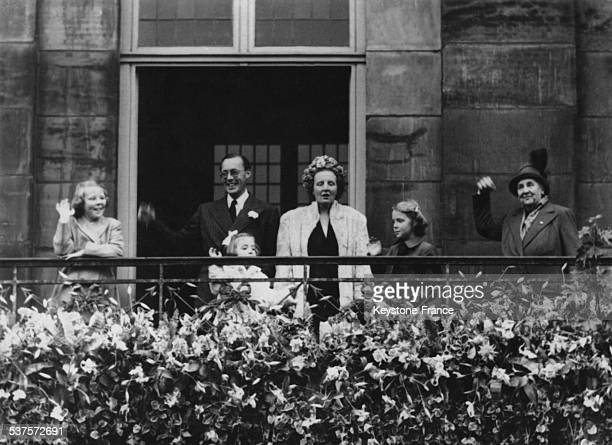 Queen Wilhelmina Princess Juliana Prince Bernhard and little Princesses Beatrix Irene and Margriet on the balcony of the Palace during the Feast of...