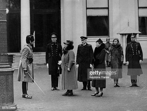 Queen Wilhelmina's talking to a colonel Princess Juliana behind on March 15 1934 in The Hague Netherlands