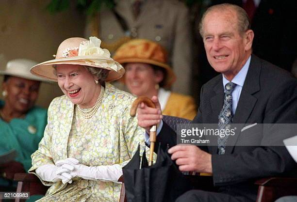 Queen With Prince Philip Laughing As She Watches Display Of Young Zulus Dancing During Her Visit To South Africa They Praised Her For Bringing Rain...