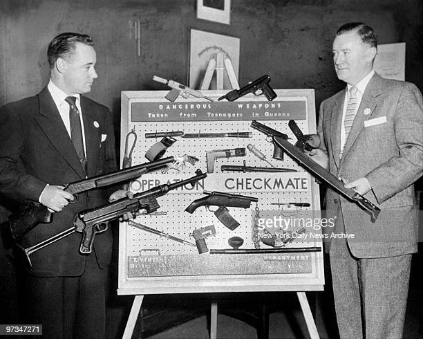 Queens Assistant District Attorney Francis X Smith and Assistant Chris Gorman inspect weapons confiscated from teenage criminals