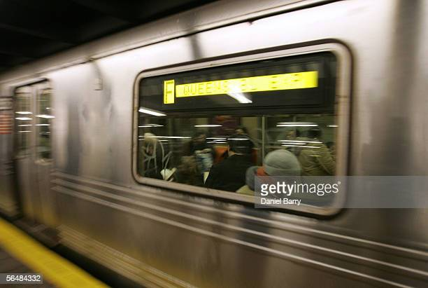 Queens bound F train rolls though the Jay Street subway station December 23 2005 in New York City After three days of strikes New York City subways...