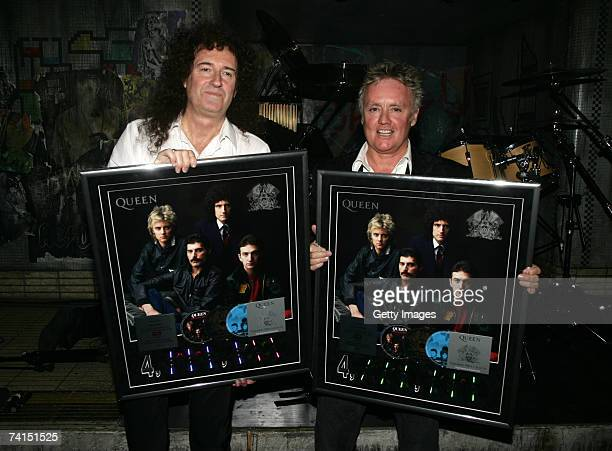 Queen's Brian May and Roger Taylor pose backstage with awards for the sale of 4 million copies of The Platinum Collection at the Dominion Theatre as...