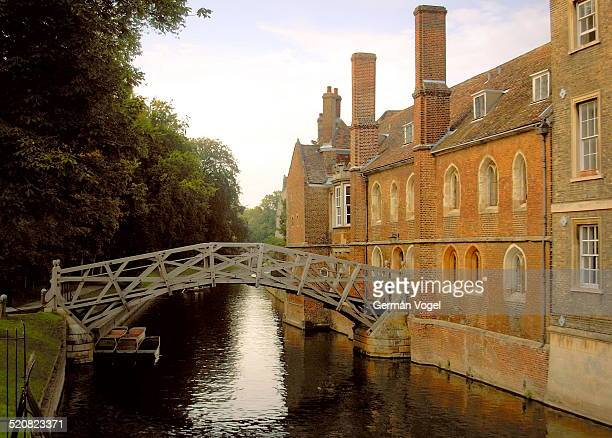 Queen's college of the University of Cambridge and bridge above river Cam from the Backs.