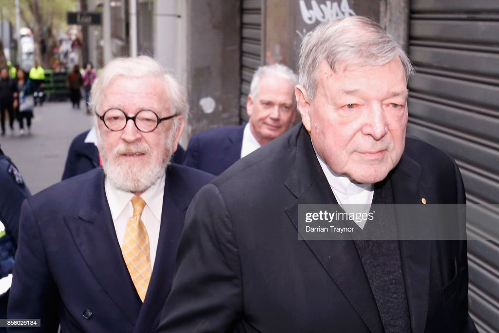 Queens Counsel Robert Richter walks with his client Cardinal George Pell from his office to the Melbourne Magistrates' Court on October 6, 2017 in Melbourne, Australia. Cardinal Pell was charged on summons by Victoria Police on 29 June over multiple allegations of sexual assault. Cardinal Pell is Australia's highest ranking Catholic and the third most senior Catholic at the Vatican, where he was responsible for the church's finances. Cardinal Pell has leave from his Vatican position while he defends the charges.