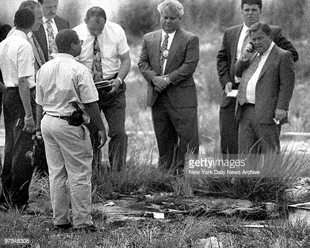 Queens District Attorney Richard Brown leads team of detectives at scene of remains of the serial killer Joel Rifkin near JFK airport
