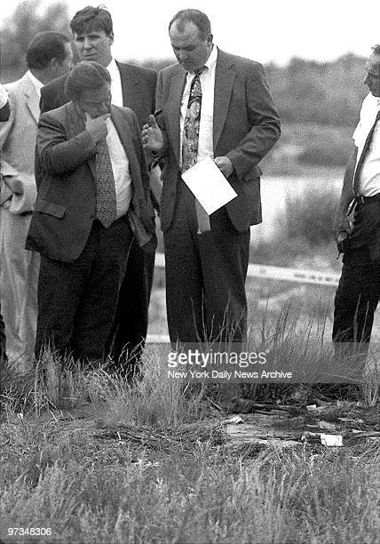 Queens District Attorney Richard Brown talks with detectives as they examine the skeleton remains of one of the serial killer Joel Rifkin's victim in...