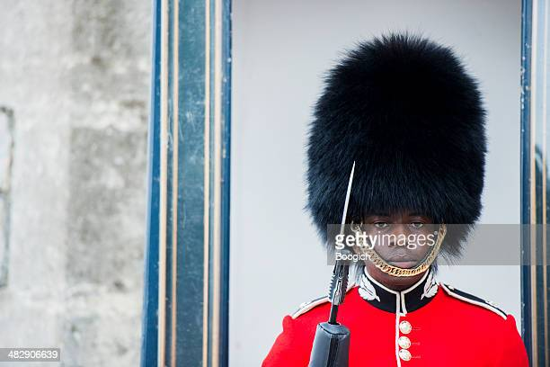 queen's guard stands on duty at windsor castle - imperial system stock photos and pictures