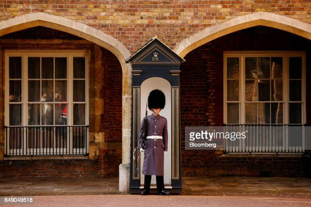 A Queen's Guard stands on patrol beside a sentry box outside St James Palace in London UK on Thursday March 2 2017 UK Prime Minister Theresa May set...