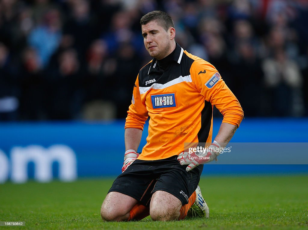 Queens Park goalkeeper Neil Parry looks on dejected after Rangers scored a last minute goal during the IRN-BRU Scottish Third Division match between Queens Park and Rangers at Hampden Park on December 29, 2012 in Glasgow, Scotland.
