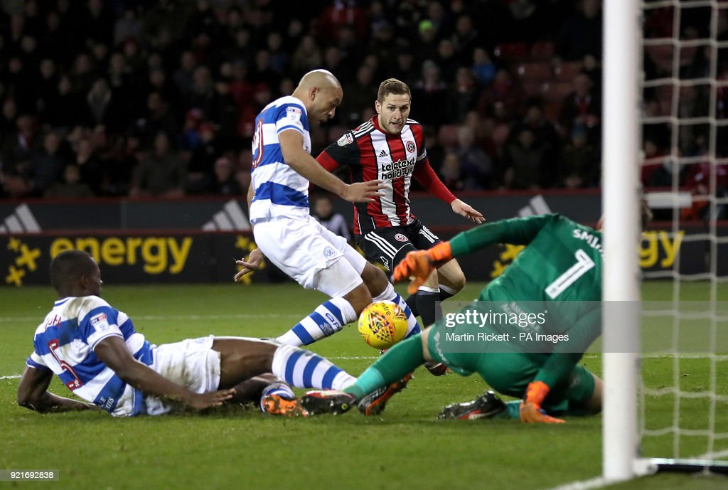 Queens Park Rangers' Alex Baptiste clears the ball from the path of Sheffield United's Billy Sharp during the Sky Bet Championship match at Bramall Lane, Sheffield.