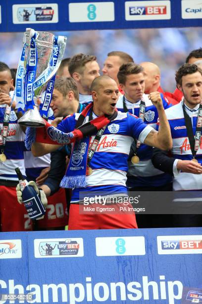 Queens Park Rangers' Bobby Zamora celebrates with the Sky Bet Championship Play Off Trophy