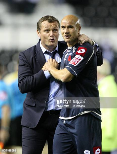 Queens Park Rangers captain Gavin Mahon and manager Jim Magilton celebrate after the final whistle