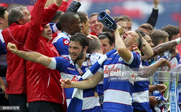 Queens Park Rangers' Charlie Austin and Clint Hill celebrate with champagne after the game