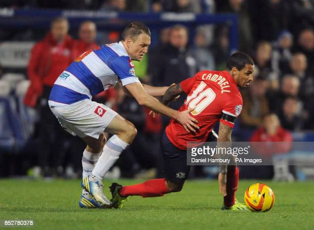 Queens Park Rangers' Clint Hill and Blackburn Rovers' DJ Cambell during the Sky Bet Championship match at Loftus Road London