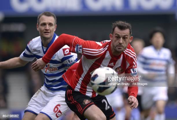 Queens Park Rangers' Clint Hill and Sunderland's Steven Fletcher battle for the ball
