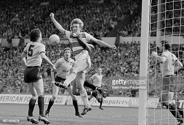 Queens Park Rangers defender Alan McDonald causing problems for the Oxford United defence and goalkeeper Alan Judge during the Milk Cup Final at...