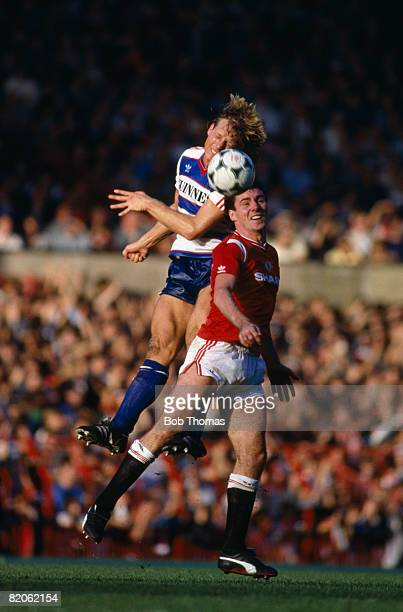 Queens Park Rangers defender Steve Wicks outjumps Manchester United's Frank Stapleton during their match at Old Trafford October 12th 1985 Manchester...
