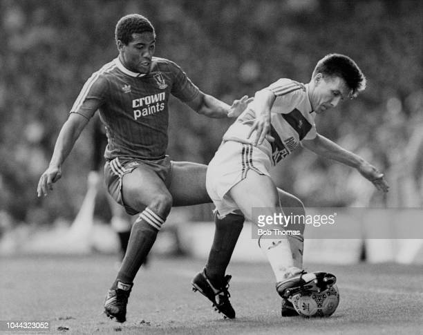Queens Park Rangers defender Warren Neill is challenged by Liverpool winger John Barnes during their Division One football match held at Anfield...