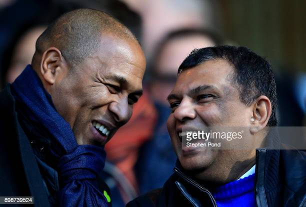 Queens Park Rangers Director of Football Les Ferdinand and Owner Tony Fernandes share a joke during the Sky Bet Championship match between Ipswich...