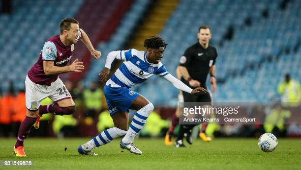 Queens Park Rangers' Eberechi Eze breaks away from Aston Villa's John Terry during the Sky Bet Championship match between Aston Villa and Queens Park...