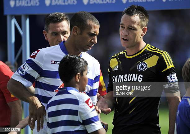 Queens Park Rangers' English defender Anton Ferdinand avoids shaking hands with Chelsea's English defender John Terry before the English Premier...