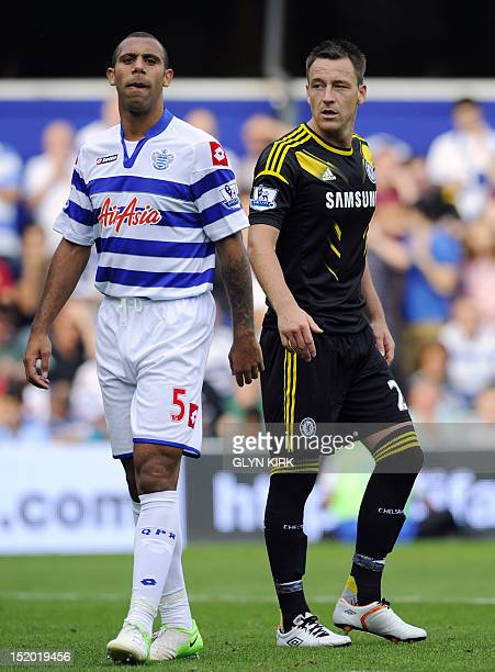 Queens Park Rangers' English defender Anton Ferdinand is seen with Chelsea's English defender John Terry during the English Premier League football...