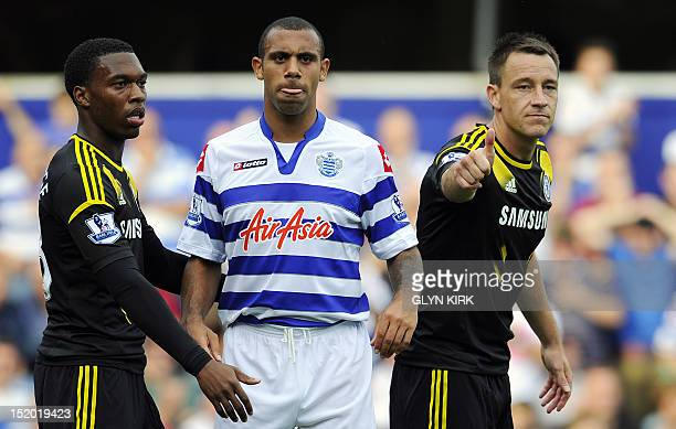 Queens Park Rangers' English defender Anton Ferdinand waits with Chelsea's English defender John Terry during the English Premier League football...