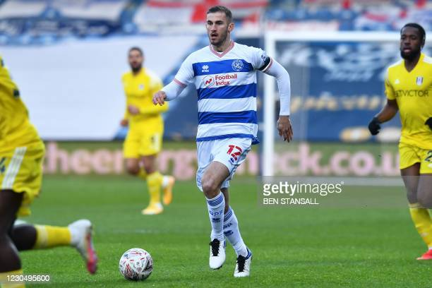 Queens Park Rangers' English defender Dominic Ball runs with the ball during the English FA Cup third round football match between Queens Park...