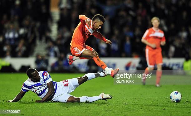 Queens Park Rangers' English defender Nedum Onuoha vies with Swansea's English midfielder Scott Sinclair during the English Premier League football...