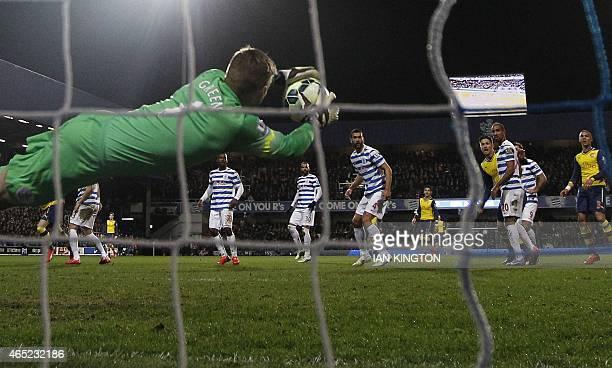 Queens Park Rangers English goalkeeper Robert Green makes a save during the English Premier League football match between Queen's Park Rangers and...