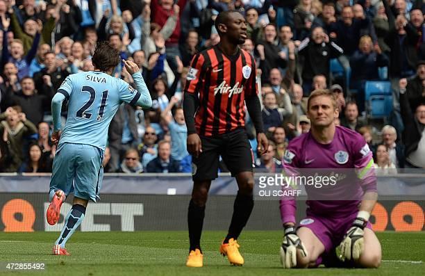 Queens Park Rangers' English goalkeeper Robert Green reacts after Manchester City's Spanish midfielder David Silva scored the team's sixth goal...