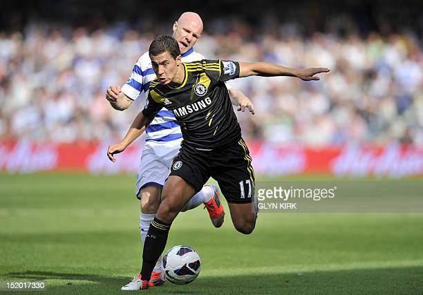 Queens Park Rangers' English striker Andrew Johnson vies with Chelsea's Belgian midfielder Eden Hazard during the English Premier League football...