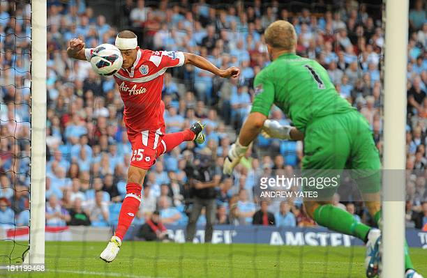 Queens Park Rangers' English striker Bobby Zamora scores past Manchester City's English goalkeeper Joe Hart during the English Premier League...